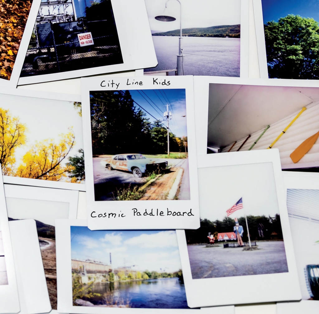 An album cover that has a bunch of instant photos from around the Upstate New York area.