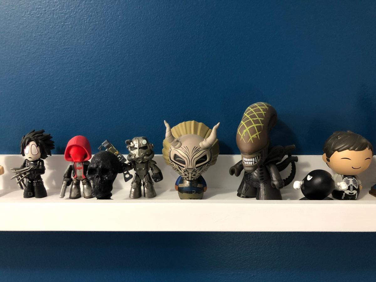 A line of pop culture figurines.