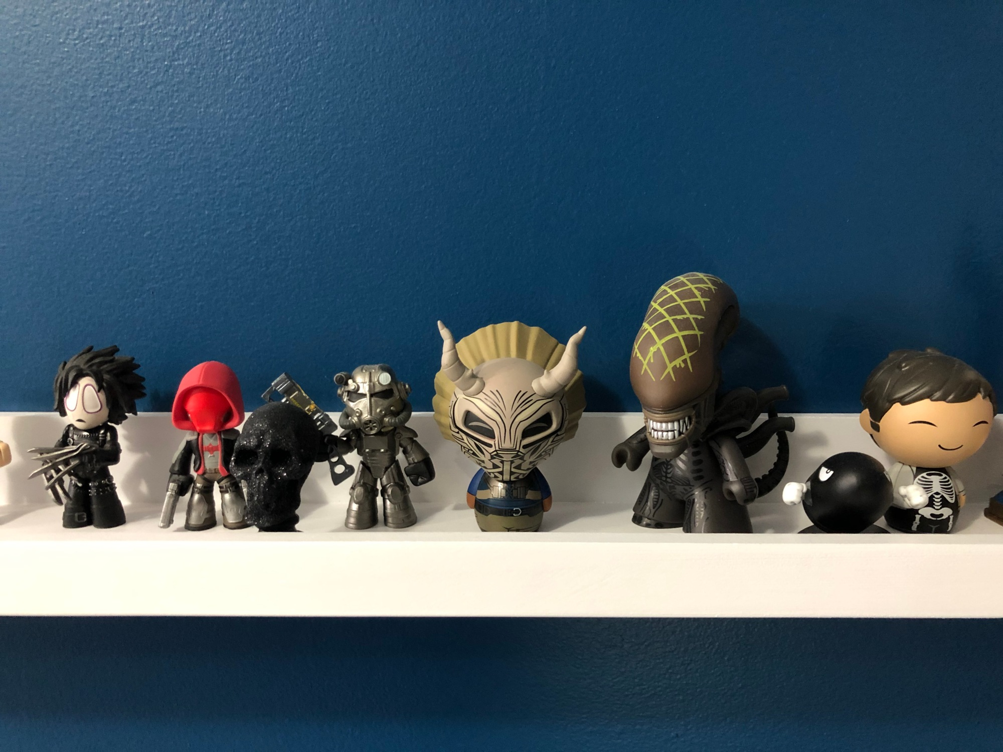 A line of pop culture figurines.